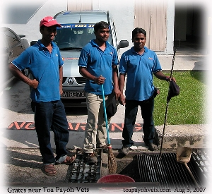 Happy Grate Maintenance workers outside Toa Payoh Vets.