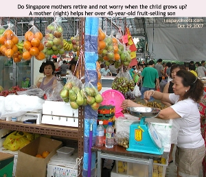 Mother helping son to sell fruits on a Sunday morning. Toa Payoh Vets.