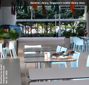 Singapore's National Library's mobile library bus and birds at breakfast. Toa Payoh Vets