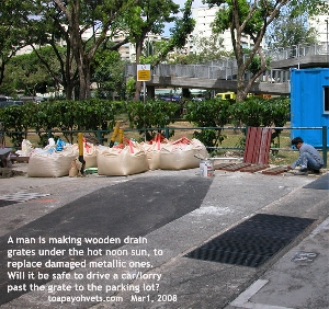 Hot noon sun, worker making wooden drain grates. Toa Payoh Vets
